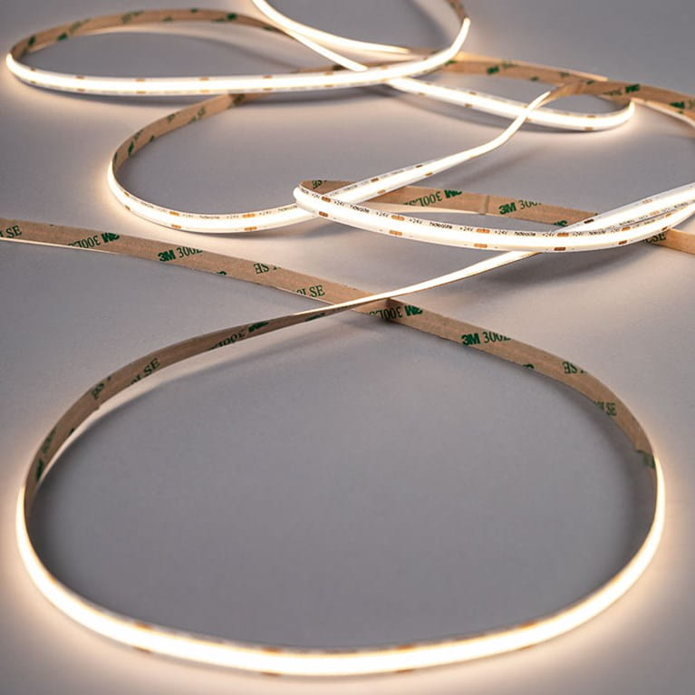 A LEDstrip with short spacing between the LEDs creates an even illuminated line without profile or cover.