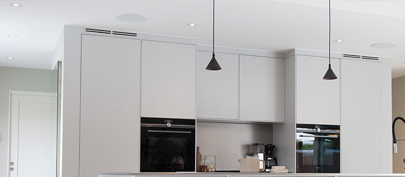 Light gray kitchen illuminated with Bright Eye Square I from Hidealite at home at Johanna Haglund, Design of.
