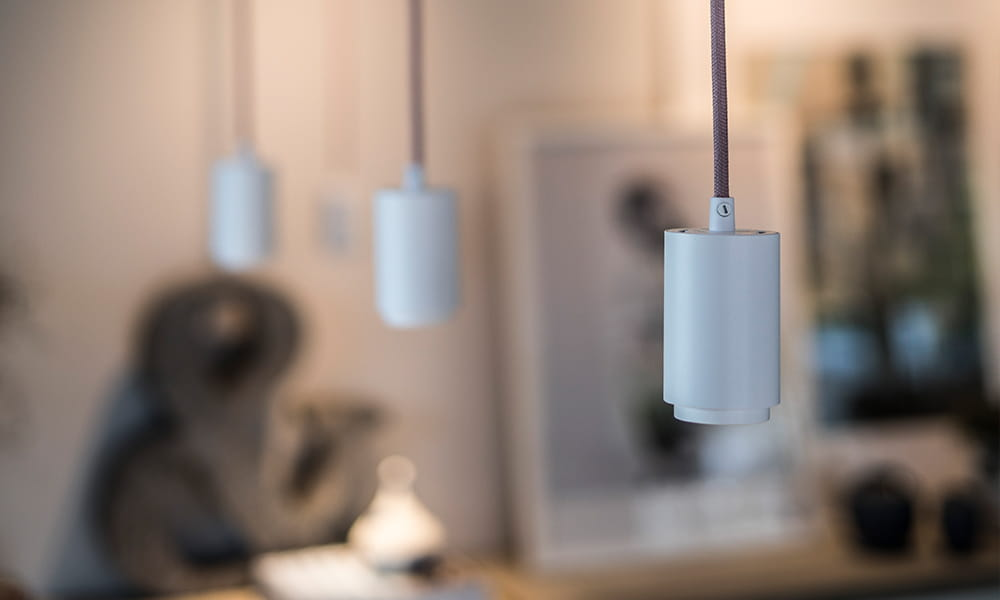 Focus Pendant Micro with pink fabric cable from Hidealite is placed on a Litetrac rail.