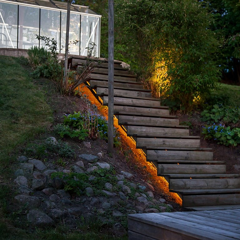 Hidealites LEDstrip HV placed under a stair outdoor in a garden.