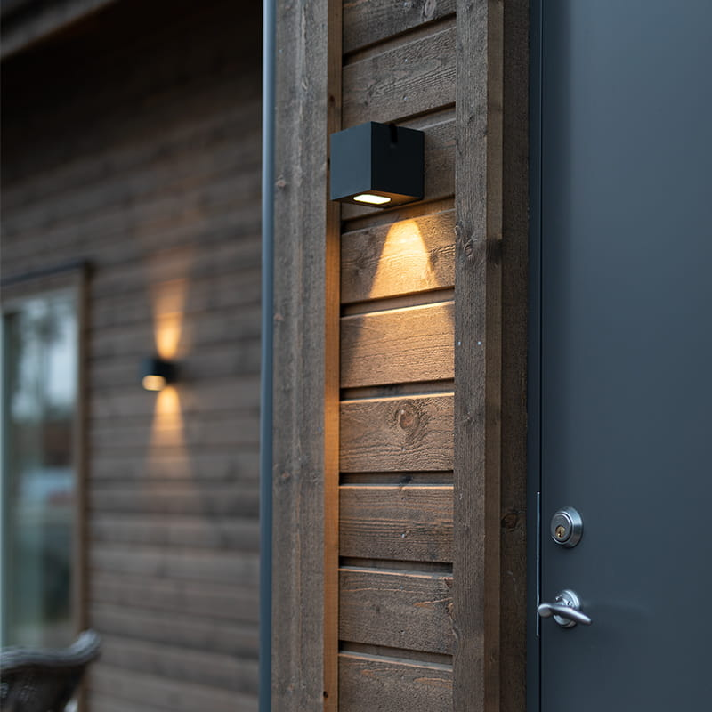 Hidealites outdoor luminaire Cube I and Cube II placed on a house facade.
